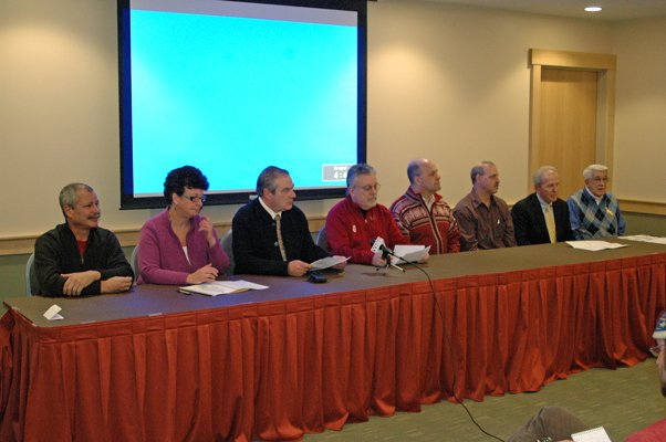 Clyde Rabideau, Kareen Tyler, Jim McKenna, Jim Goff, Jack Favro, Randy Douglas, Jeff Byrne and Ron Keough talk about the upcoming Empire State Winter Games at their Jan. 5 press conference.