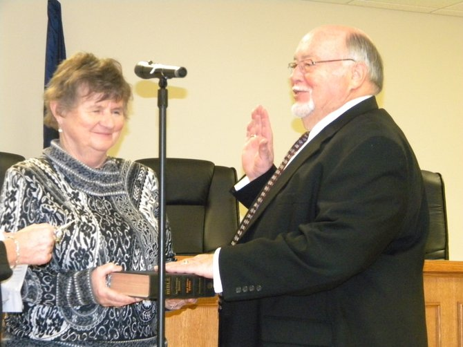 John Salisbury is sworn into the position as Lysander Supervisor Jan. 1 as his wife, Mary, holds the Bible for him.
