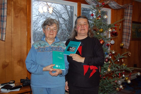 Dana and Yvona Fast hold the English and Polish version of Dana's memoirs.