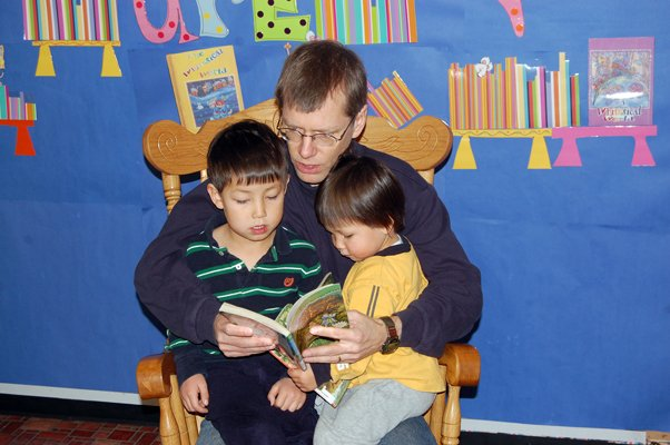 Kurtis Hagen reads to his children, Kai, 4, and Erik, 2, at Plattsburgh Public Library.