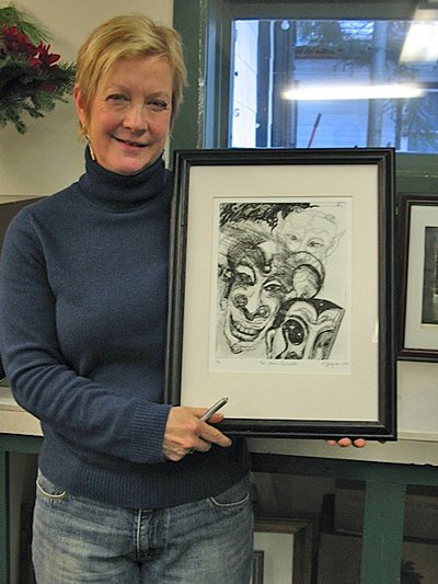 Schroon lake artist/printmaker Anne Gregson poses with one of her Solarplate works, ‘Too Much Carnivale. ‘Three of her prints are featured in the ‘Winter Magic’ exhibit that opens this weekend in the Art in Chester Gallery.