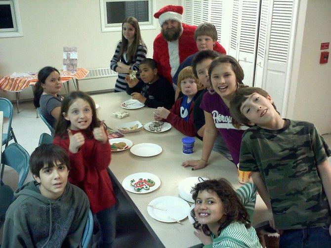 Children from B'ville C.A.R.E.S. Kids Kount program visit with Santa on Dec. 19.