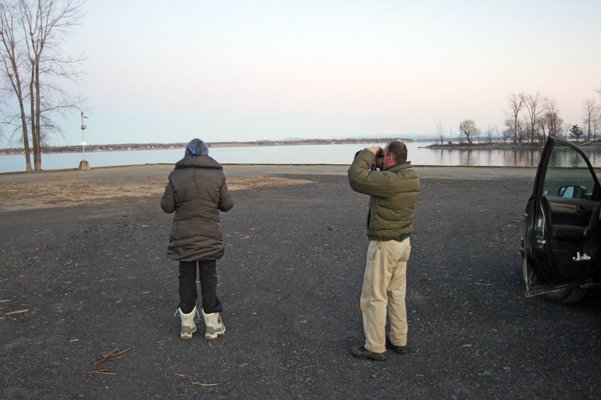 Brian McAllister of Saranac Lake (Right with binoculars) and Linda LaPan of Lake Placid watch for CBCs.