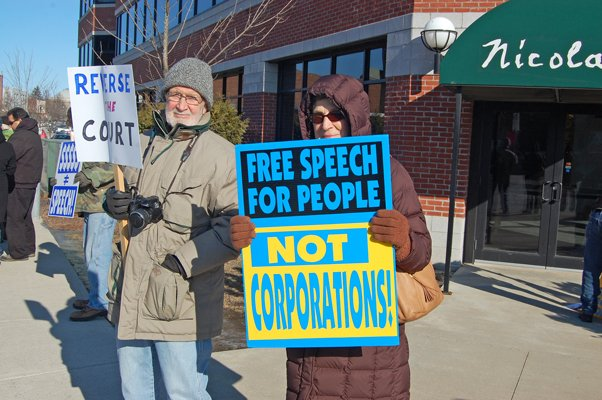 Bill Cowan and Rita FitzGerald participated in the public demonstration opposing Citizens United outside Congressman Bill Owens office on Jan. 20.
