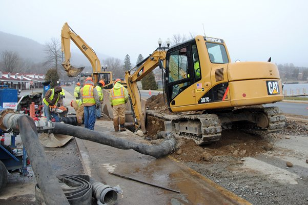 In 2010, workmen install a new water line under Beach Road. After an upcoming reconstruction project to the popular and famous roadway, stormwater will be drained through porous pavement and be filtered rather than be dumped into Lake George.
