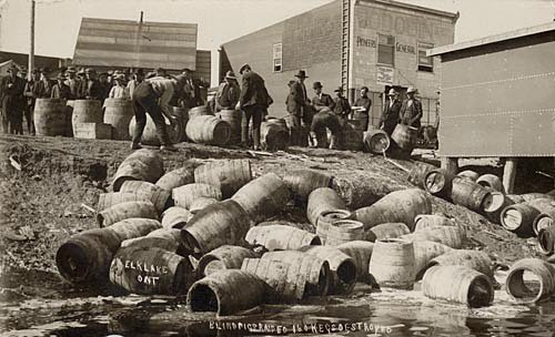 Canadian law enforcement officers destroy barrels of liquor in a 1925 raid against bootleggers in Elk Lake, Ontario. 