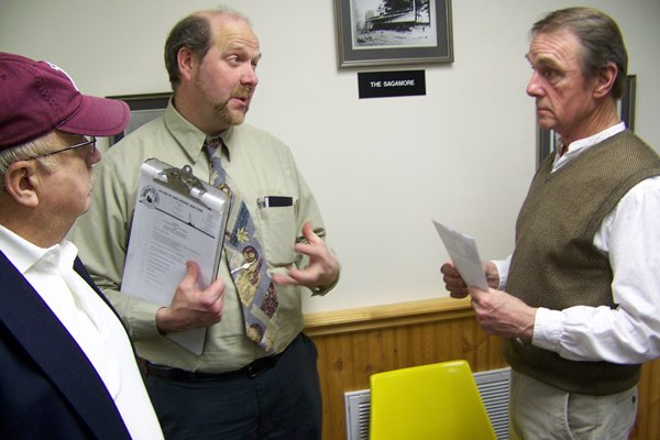 Following a rare joint intermunicipal meeting held Tuesday Jan. 24, Lake George Village Superintendent of Public Works Dave Harrington (center) talks to Lake George Town Supervisor Dennis Dickinson (right) and town board member Dan Hurley (left) about the prospects of converting the two government facilities to solar power.