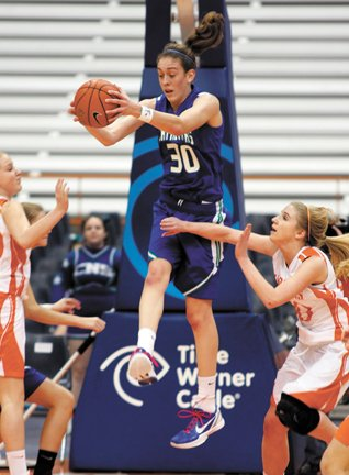 Cicero-North Syracuse senior forward Breanna Stewart (30) leaps for a rebound while Liverpool player Katie Dalton tries to block her in a December game in the Carrier Dome. Stewart was just named USA Basketball's Female Athlete of the Year.