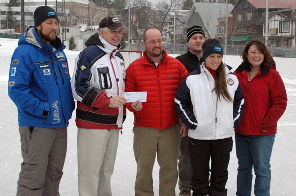 Luge coach and former Empire State Games competitor Pat Anderson, North Elba Supervisor Roby Politi, Doug Bauer of C&S Companies, youth olympian and ESG competitor Raychel Germaine, Ben Johnson of C&S and Kimberly Fabend of C&S pose as Bauer presents Politi with a check for $2,500 towards the 32nd annual games.