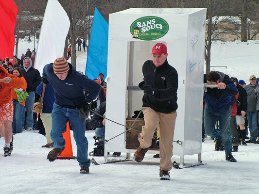 ITS CARNIVAL TIME! Competitors in the 2009 Lake George Winter Carnival outhouse race drag their custom-built craft across the lake ice toward a finish line. This years competition, to be held in the Fort William Henry parking lot due to lack of lake ice, is to be filmed by a national cable television channel.