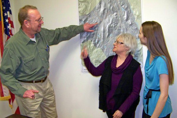 Fred Engelmann of Rainmaker Network of Chestertown points out, on a map of Thurman, possible transmission points for broadband in town via 'white space' technology. Listening are (right) Thurman Supervisor Evelyn Wood and (center) Ava  Ashendorff of Chestertown — a member of U.S. Rep. Chris Gibson's citizen's committee, who is credited with bringing Engelmann and Wood together for their broadband initiative.