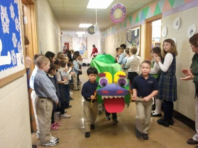 Mrs. Cathy Schotthoefer's kindergarten class at St. Mary's Academy in Baldwinsville celebrate the Chinese New Year with a parade around the school.