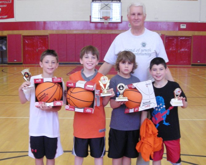 Baldwinsville Optimist Donald Varn stands with winners from last year's foul shooting contest. This year's event will be held from 10 a.m. to noon March 10 at Durgee Junior High School.