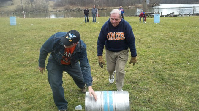 Fayetteville's Chuck Reschke, left, and Bob Krause, of Onondaga Hill, roll their keg over the finish line during the club's winter Olympics held this past Saturday in Baldwinsville. Both of the men are members of the Liverpool Elks Club.