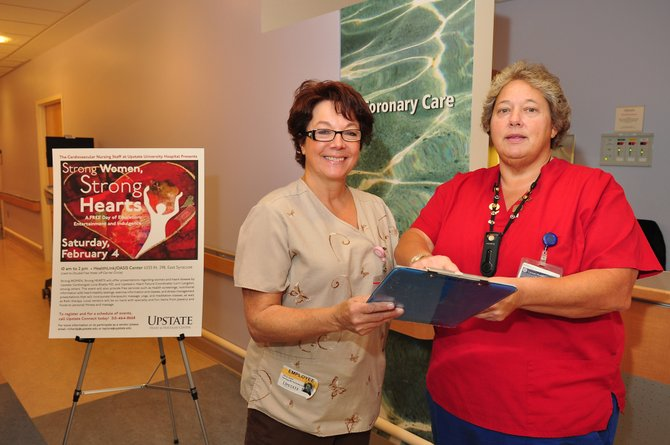 Alicia Taylor, RN, left, and Patricia Richardson, RN, discuss plans for Strong Women, Strong Hearts.