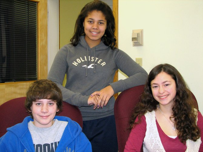 Durgee Junior High School eighth-graders Brina Reed, back, Nicholas Spurchise, seated left, and Maria Ragonese were winners in the local portion of the 2012-13 Elks Americanism Essay Contest, sponsored by the Liverpool Elks Lodge 2348.