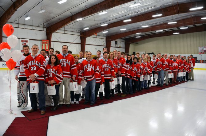 Members of the Baldwinsville varsity ice hockey team are joined by their favorite teachers on the ice before the start of the team's home game on Feb. 3.