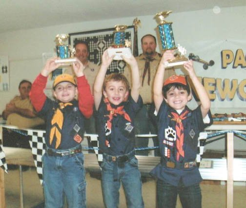 First-grader Dan Allen, right, a member of Baldwinsvilles Cub Scouts Pack 248, took first place in the packs annual Pinewood Derby. With him are first-grader Ayden Hickey, center, who took second place in the contest, and second-grader Aiden Kalim Delorio, who took third place.