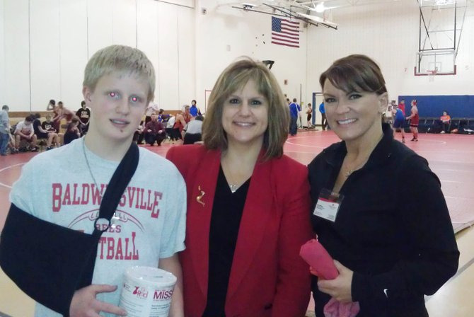 Patrick O'Neil, left, helped organize a fundraiser through the Ray Middle School wrestling team to benefit the American Heart Association with the help of his mother, right.