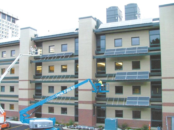 Pictured are solar panels being installed by IBEW/NECA electricians at the Baker Labs Building at Syracuse University.