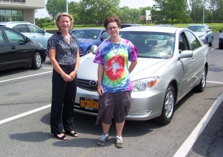 Brittany Butler, right, stands with the car she won during last year's Keep the Ball Rolling event. With her is Kelly Pelcher of Burdick Automotive BMW, Ford, Lexus, and Toyota Scion, the company that donated the car to the event.