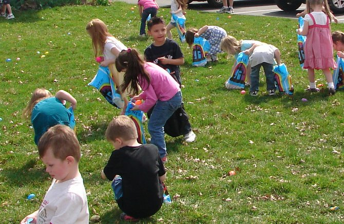 Children hunt for Easter eggs during the Wesleyan Community Church's Eggs-travaganza last year.