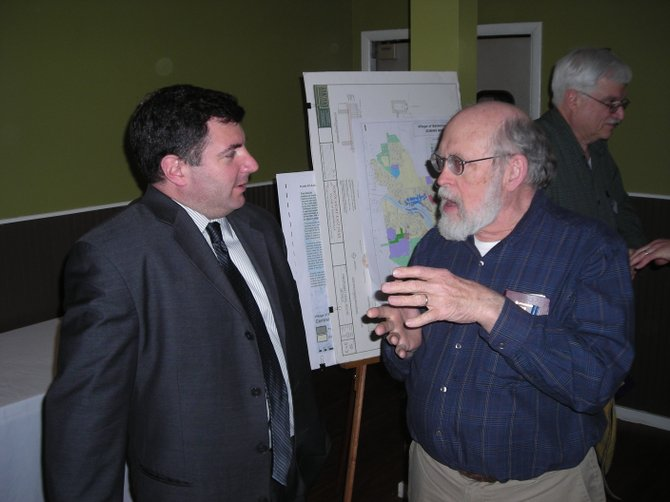 Baldwinsville Mayor Joe Saraceni discusses some of the village's future projects with Baldwinsville Optimist member Thom Conklin during a break at an Optimist dinner meeting March 12.