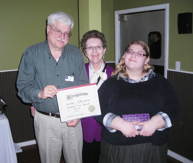 Justine Silberman, right, receives her Student of the Month Certificate from B'ville Optimist President Jim Johnson, left, and Joyce Ramseyer, who is the chairperson for the Optimist student of the month award.