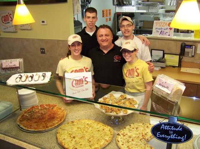 Owner Tony Calascibetta, center, stands with his new staff at the Moyer's Corners Cam's Pizzeria (from left) Sarah Bowers, of Baldwinsville, managers Shayne Roach and Steve Richmond, and Allie Benz, who are all from Liverpool.