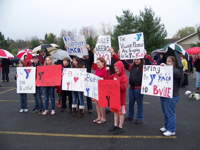 Residents of Baldwinsville display signs they made to show support for building a YMCA at Smokey Hollow Plaza in Baldwinsville.