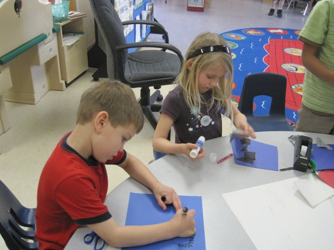 Grady Hudson, left, and Graycen Wilford work on an art project at St. Elizabeth Ann Seton Preschool. 