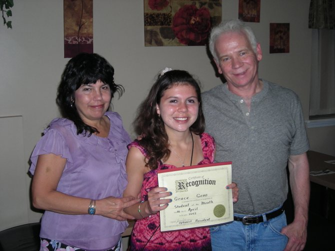 Grace Geno, center, Baldwinsville Optimist Club&#39;s Student of the Month for April, is pictured with her proud parents, Marge, left, and Dennis.