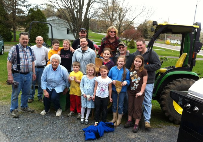 Plainville Christian Church UCC members young and old, big and small gather April 15 to work on their annual spring grounds cleanup.