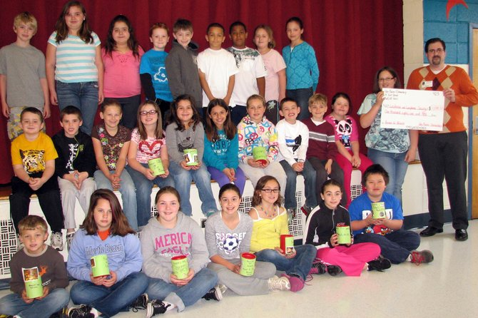 "Van Buren Elementary School students who acted as classroom representatives in the school's ""Pennies for Patients"" collection present the school's donation to Daniel Wood, a volunteer with The Leukemia & Lymphoma Society."