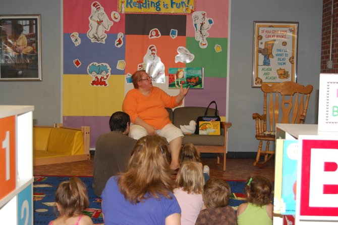 Karen Ricketson reads to children at the Plattsburgh Public LIbrary.