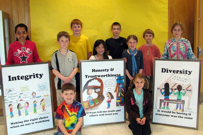Students who created the posters are (back row, from left) Jack Stone, Caleb Conley, Andrew Millard, (front row, from left) Rachael Dunbar, Ryan Covert, Bianca Gascon, Jessica Bilynsky, Summer McClintic, (kneeling) Alexander Jacobson and Catherine Iven.