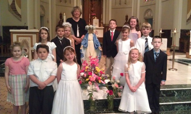 (Bottom row, from left) Madison Troendle (received Sacrament 2011), Andrew Janowski, Eleanor Black, Mylaina Dukat, Liam Rose, (second row, from left) Ola Bednarczyk, Michael Wolniak, Felicity Pickard, Sara Hunter, Casey Burke, (third row, from left) Jack Ramin and Maeve Bartell, second grade students at St. Mary's Academy, recently received the Sacrament of Communion during the month of May.