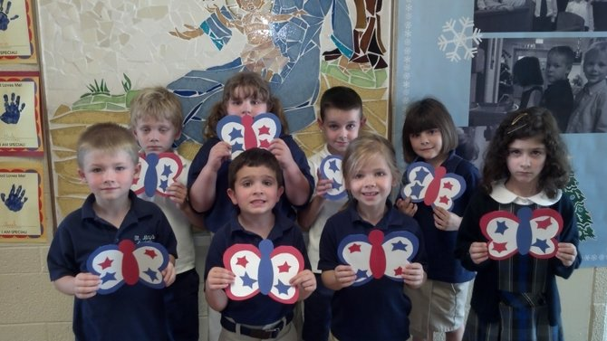 The Kindergarten students of St. Mary's Academy share a little cheer this Memorial Day with the patients of the VA hospital in Syracuse.