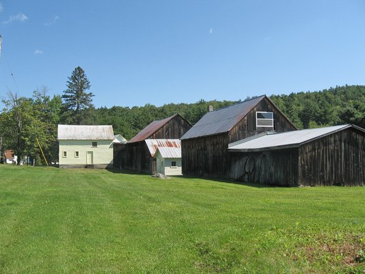 A cluster of barns at former Orley Needham farm, now an event venue known as Burlap &amp; Beams, provides a charming backdrop for weddings and special events. 