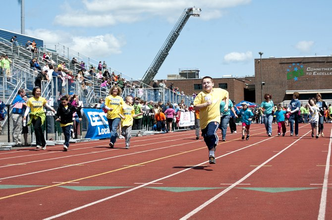 Jack Denny, 10, of Baldwinsville, leads the 100m dash at the Special Olympics, which took place Thursday morning, May 17, at the Cicero-North Syracuse High School Athletic Complex.