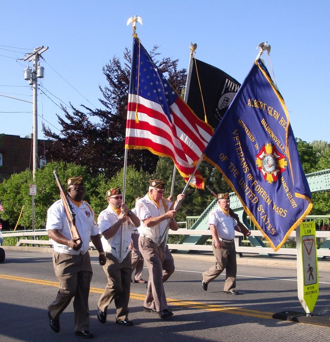 Veterans display American flags during Baldwinsville's Memorial Day Parade held on May 30.