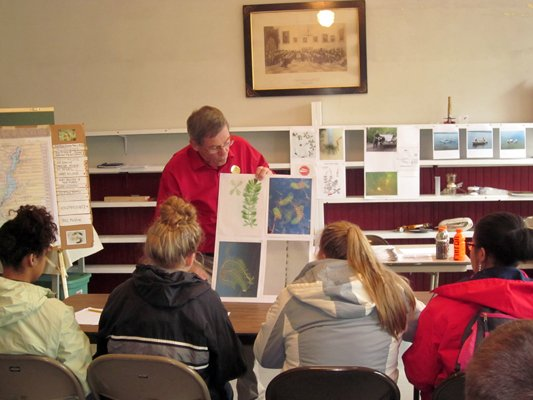 The East Shore Schroon Lake Association recently hosted 13 students and their chaperones from the West Michigan Academy of Environmental Science.  Vince Blando talked about Eurasian Water Milfoil.