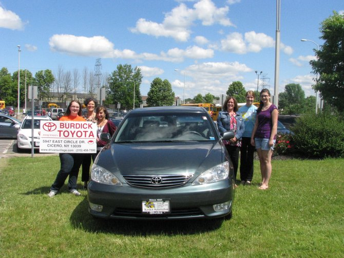 Cicero-North Syracuse High School's Students Against Destructive Decisions group is putting on an After the Ball Party after the school's Senior Ball to discourage students from getting into trouble. As an incentive to encourage students to attend, Burdick Toyota has donated a car for one lucky student to win. Pictured with the car are, from left, SADD President Sarah Knickerbocker, club co-advisor Michele Barbagallo, Tori Florczyk, co-advisor Sara Villnave, Anna Doren and Kayla Ventura.