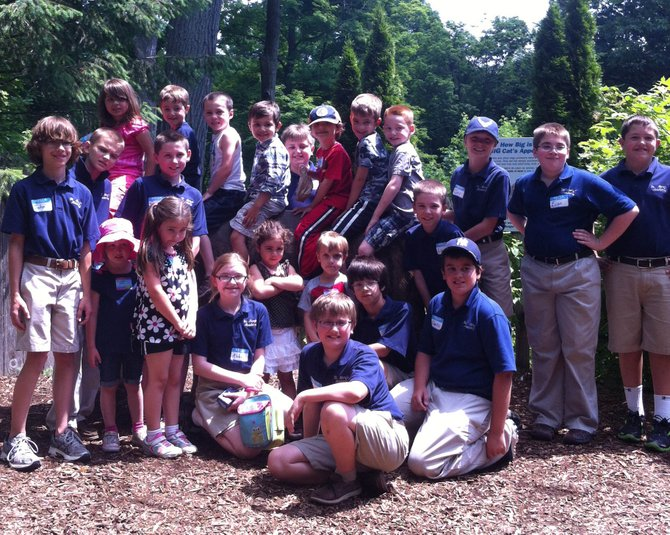 Pre-K students and their fifth grade reading buddies at St. Mary's Academy recently shared a day at the Burnett Park Zoo.