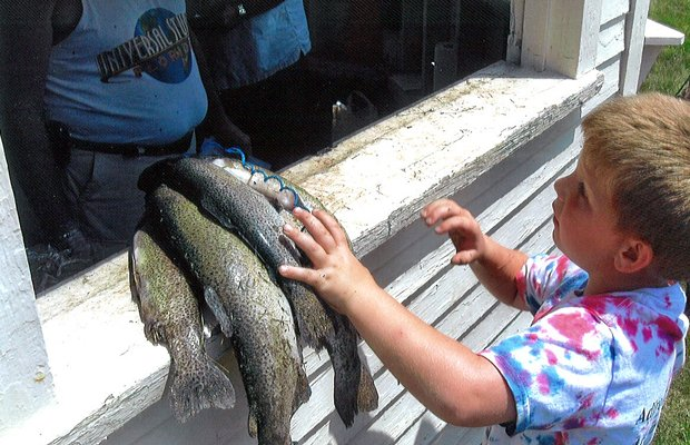 Mason Phinney brings his catch to be weighed at E'town's trout fishing derby 2012.