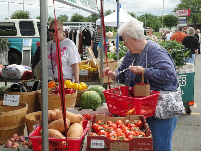 Jill Zoll from the Cicero Senior Center shops for fresh produce at the newly opened Cicero Farmers Market at Drivers Village. The market held its grand opening Tuesday, June 5.
