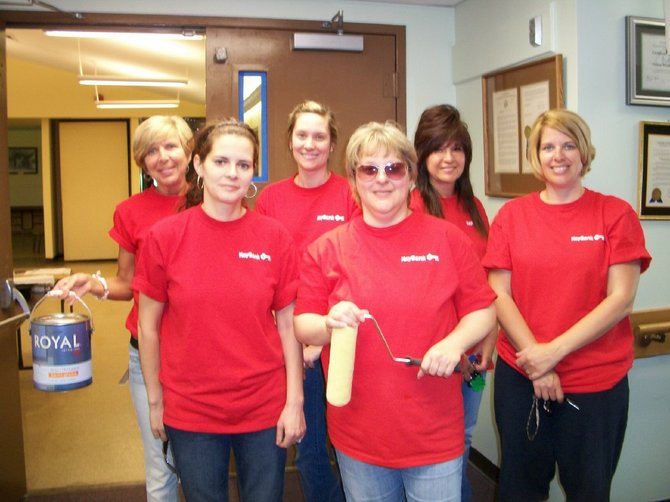 Generous volunteers from KeyBank in Baldwinsville donated their time painting at Canton Woods Senior Center on KeyBank's Neighbors Make a Difference Day.