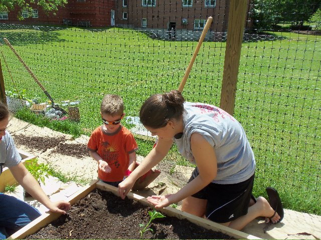 Campbell Bagley, right, and Gabby Clover help build the Grace Episcopal Church garden in Baldwinsville, will help keep fresh vegetables on stock for the Baldwinsville Food Pantry.