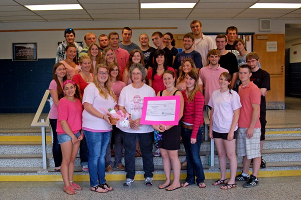The Johnsburg Central School senior class poses with breast cancer survivor Sandy Ordway (front row, third from left), a food service worker at the school. The class raised money for breast cancer awareness this past year.