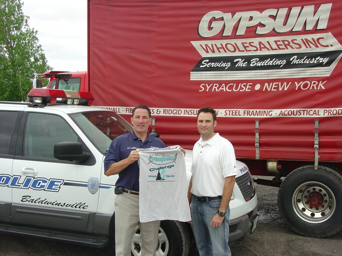 Baldwinsville Police Lt. Thomas LeRoy, left, and Gypsum Wholesalers Controller Michael Flynn display this year's Ropes Challenge T-shirts.